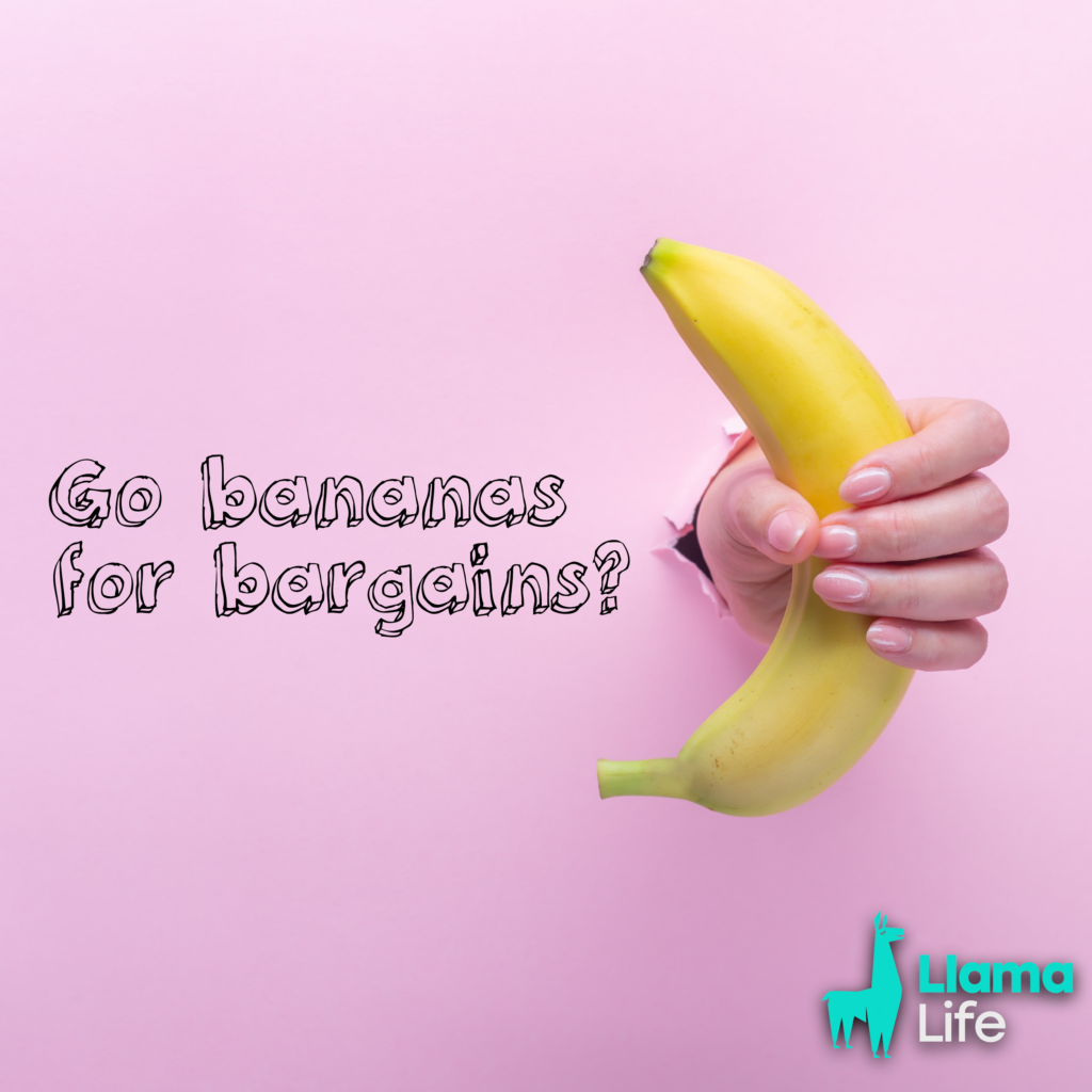 Hand holding a banana witht he Lllama Life logo on side