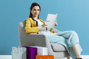 Women reading catalog, Shopping is changing